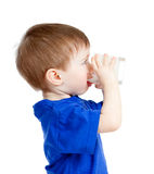 Little child drinking yogurt or kefir over white. Baby drinking yogurt or kefir over white Stock Images