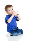 Little child drinking yogurt over white. Baby drinking yogurt or kefir on white background Royalty Free Stock Photography