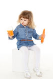 Little child drinks carrot juice. Royalty Free Stock Photo
