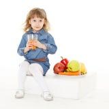 Little child drinks juice. Stock Photos