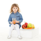 Little child drinks juice. Royalty Free Stock Images