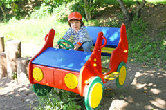 Little child drives car on playpit Royalty Free Stock Photos