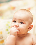 Little child eating biscuit Stock Photos