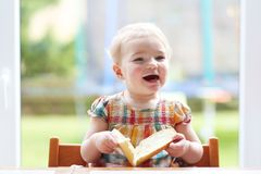 Little child eating bread with butter Stock Photography