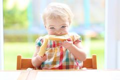 Little child eating bread with butter Stock Photos