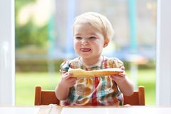 Little child eating bread with butter Royalty Free Stock Image