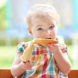 Little child eating bread with butter Stock Image
