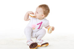 Little child eating doughnuts. Royalty Free Stock Image