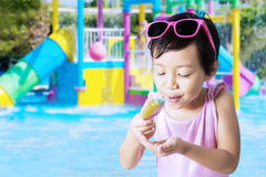 Little child eating ice cream at pool Royalty Free Stock Photos