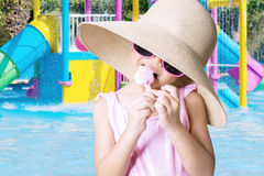Little child eating ice cream Stock Photos