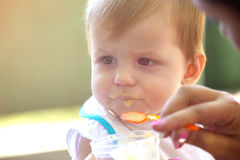 Little child is eating Stock Photo