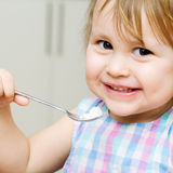 Little child eating Stock Photos