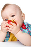 Little child is eating red apple Royalty Free Stock Photos