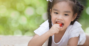 Little child eating strawberries Royalty Free Stock Photos