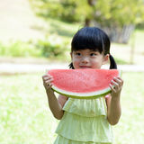 Little child eating watermelon Stock Image