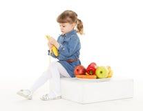 Little child eats fruit. Royalty Free Stock Photos