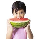 Little child eats watermelon in studio Stock Photos