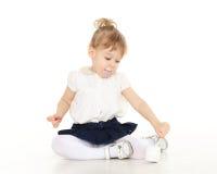 Little child eats yogurt Royalty Free Stock Images