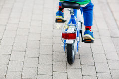 Little child on first bike. Hands of kid. Royalty Free Stock Photography