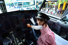 Little child fly a Boeing 737 Royalty Free Stock Photo