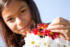 Little child with fresh flowers Royalty Free Stock Image