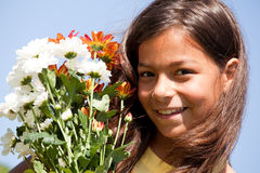 Little child with fresh flowers Stock Image