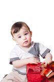Little child with a gift box Royalty Free Stock Image