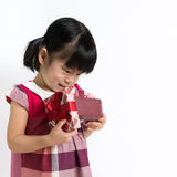 Little child with gift box Stock Photos