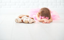 Little child girl   ballerina with ballet shoes and pointe shoes Stock Photo