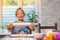 Little child girl cook at home stock photography