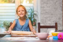 Little child girl cook at home royalty free stock photos