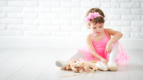 Little child girl dreams of becoming  ballerina with ballet shoe Stock Photography