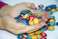 Little child girl hand play and learn magnetic alphabets on board Royalty Free Stock Image