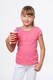 Little child girl holding a drink in disposable paper cup Royalty Free Stock Photos