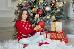Little child girl likes xmas present. Christmas. Kid enjoy the holiday. Happy new year. Christmas composition. small. Happy girl at christmas. The morning royalty free stock image