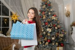 Little child girl likes xmas present. morning before Xmas. New year holiday. girl with shopping bags. Christmas. Kid. Enjoy holiday. Happy new year. small happy stock photo