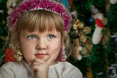 Little child girl near Christmas tree. Happy new year Stock Photos