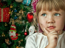 Little child girl near Christmas tree Stock Photo