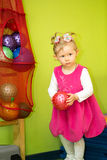 Little child girl playing with ball in kindergarten in Montessori  Class. Royalty Free Stock Image