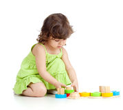 Little child girl playing with colorful toys Stock Images