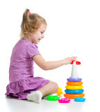 Little child girl playing with colorful toys Stock Photo