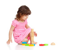 Little child girl playing with colour toys Stock Photos