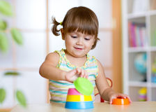 Little child girl playing with educational toys Stock Photo