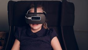 Little child girl playing game in virtual reality glasses. Professional shot in 4K resolution. 093. You can use it e.g. in your commercial video, business Royalty Free Stock Photos