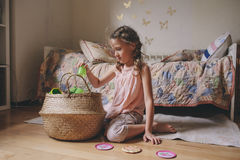 Little child girl playing in her room with toy food, cooking and having fun Royalty Free Stock Photography