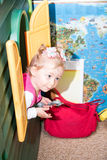 Little child girl playing in kindergarten in Montessori Class. Royalty Free Stock Image