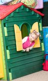 Little child girl playing in kindergarten in Montessori preschool Stock Photos