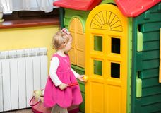Little child girl playing in kindergarten in Montessori preschool. Class stock images