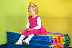 Little child girl playing in kindergarten in Montessori preschool. Class royalty free stock photo