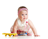 Little child girl playing musical toy Royalty Free Stock Photos